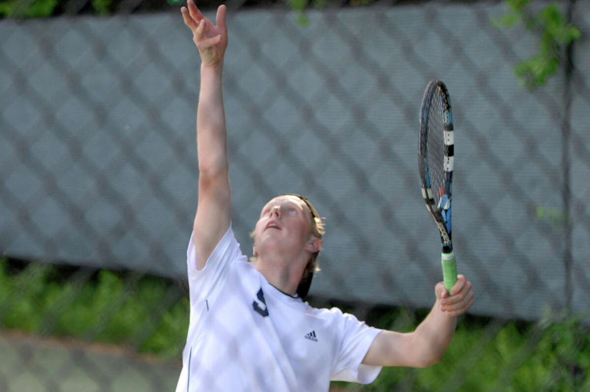 Staples' Steve Thomson serves against New Canaan. Thomson and Zack Levin won a 3-setter at first doubles in the Wreckers' 5-2 win.