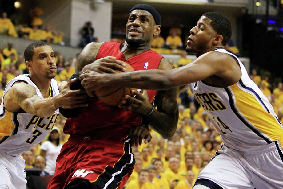 Miami Heat's LeBron James, center, goes to the basket against Indiana Pacers' George Hill (3) and Paul George, right, during the first half of Game 3 of their NBA basketball Eastern Conference semifinal playoff series, Thursday, May 17, 2012, in Indianapolis. The Pacers won, 94-75, to take a 2-1 series lead. (AP Photo/Darron Cummings) Photo: Darron Cummings, Associated Press / AP