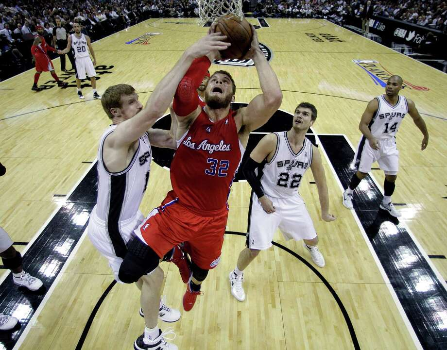 Los Angeles Clippers' Blake Griffin (32) is blocked by San Antonio Spurs' Matt Bonner, left, during the first quarter of Game 2 of an NBA basketball Western Conference semifinal playoff series on Thursday, May 17, 2012, in San Antonio. The Spurs won, 105-88, to take a 2-0 series lead. (AP Photo/Eric Gay) Photo: Eric Gay, Associated Press / AP
