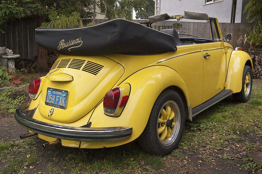 "'I didn't have a driver's license, so a friend in my college art class test-drove the car for me. He took it for a spin around town, and I remember him speeding around a corner and laughing as he said, ""This bug has a wild side - it's fast! Buy it!"" So I did.' Photo: Stephen Finerty, Photograph By Stephen Finerty -"