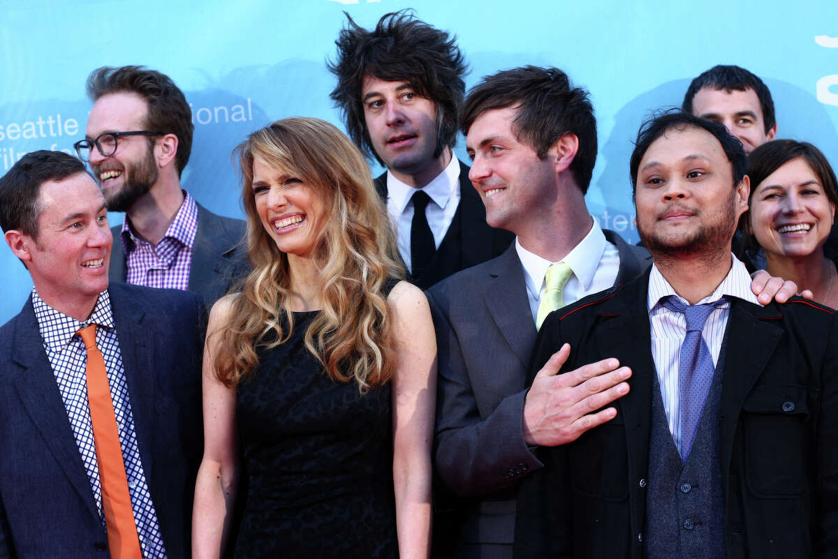 Director Lynn Shelton, center left, is surrounded by the crew that helped her make the film 'Your Sister's Sister,' shown during the opening night gala of the Seattle International Film Festival on Thursday, May 17, 2012 at McCaw Hall in Seattle. The 37th annual festival, known as one of the largest film festivals, kicked off May 17th and will continue through June 10th.