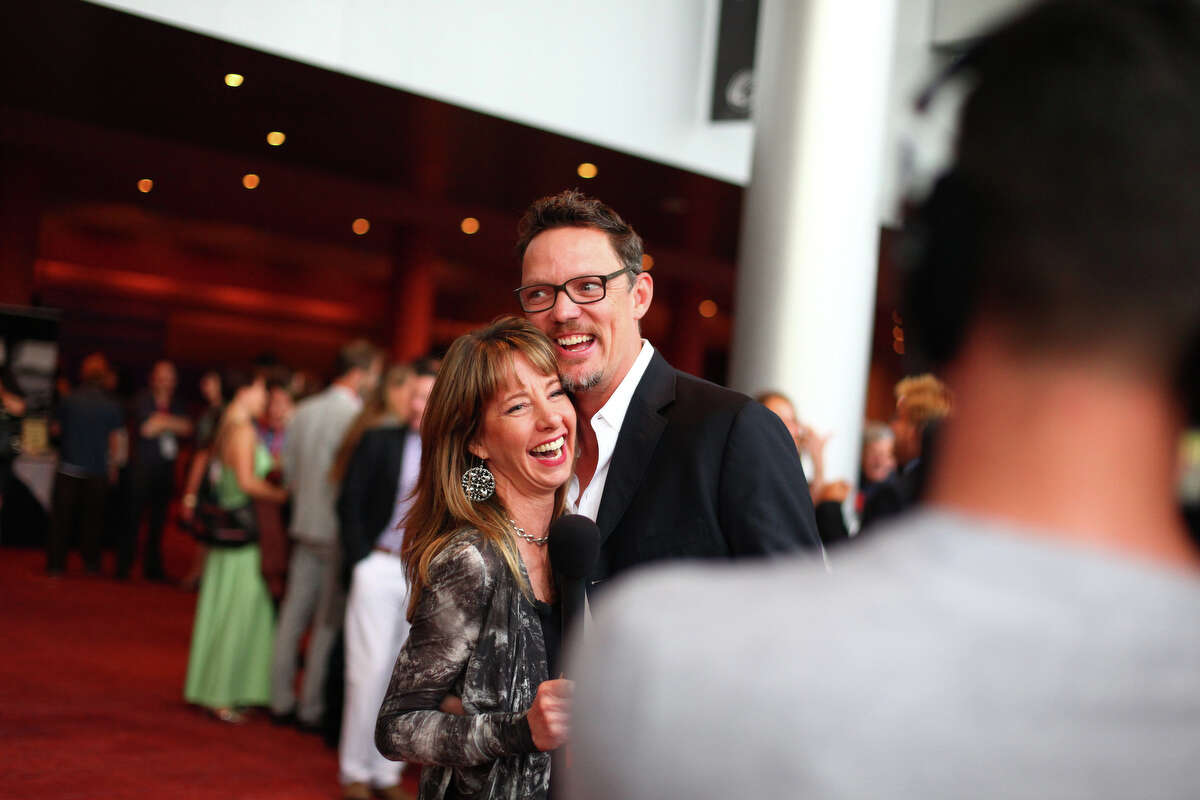 Actor Matt Lillard is embraced by television personality Nancy Guppy before a screening of the film 'Your Sister's Sister,' during the opening night gala of the Seattle International Film Festival.