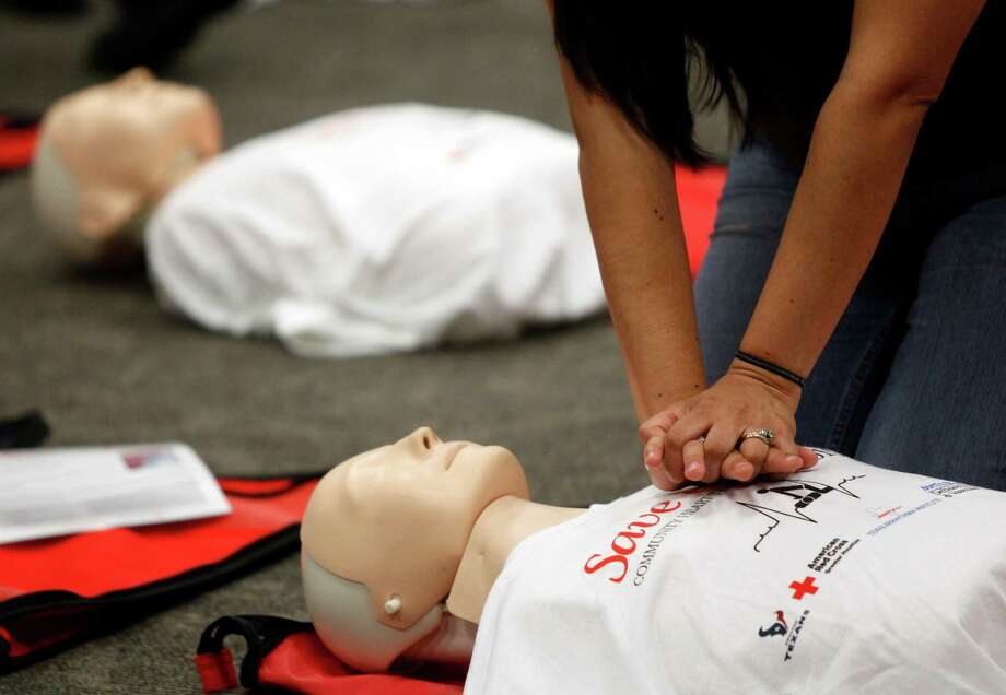 """Dania Hernandez of Houston learning hands-only CPR during the American Red Cross event """"Gabrielle Giffords Honorary Save-a-Life Saturday"""" for free lifesaving training held at NASA Gilruth Center, Saturday, March 19, 2011, in Houston. There were three location in the Houston area among the 100 locations across the country to provided free non-certifying training that included hands-only CPR and other life-saving skills such as controlling external bleeding and managing shock.   ( Melissa Phillip / Houston Chronicle ) Photo: Melissa Phillip / Houston Chronicle"""