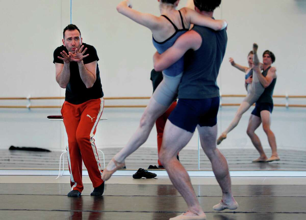 Choreographer Nicolo Fonte, highly animated in the studio, works with dancers Melody Mennite and Peter Frank to develop a tricky lift in his new ballet.