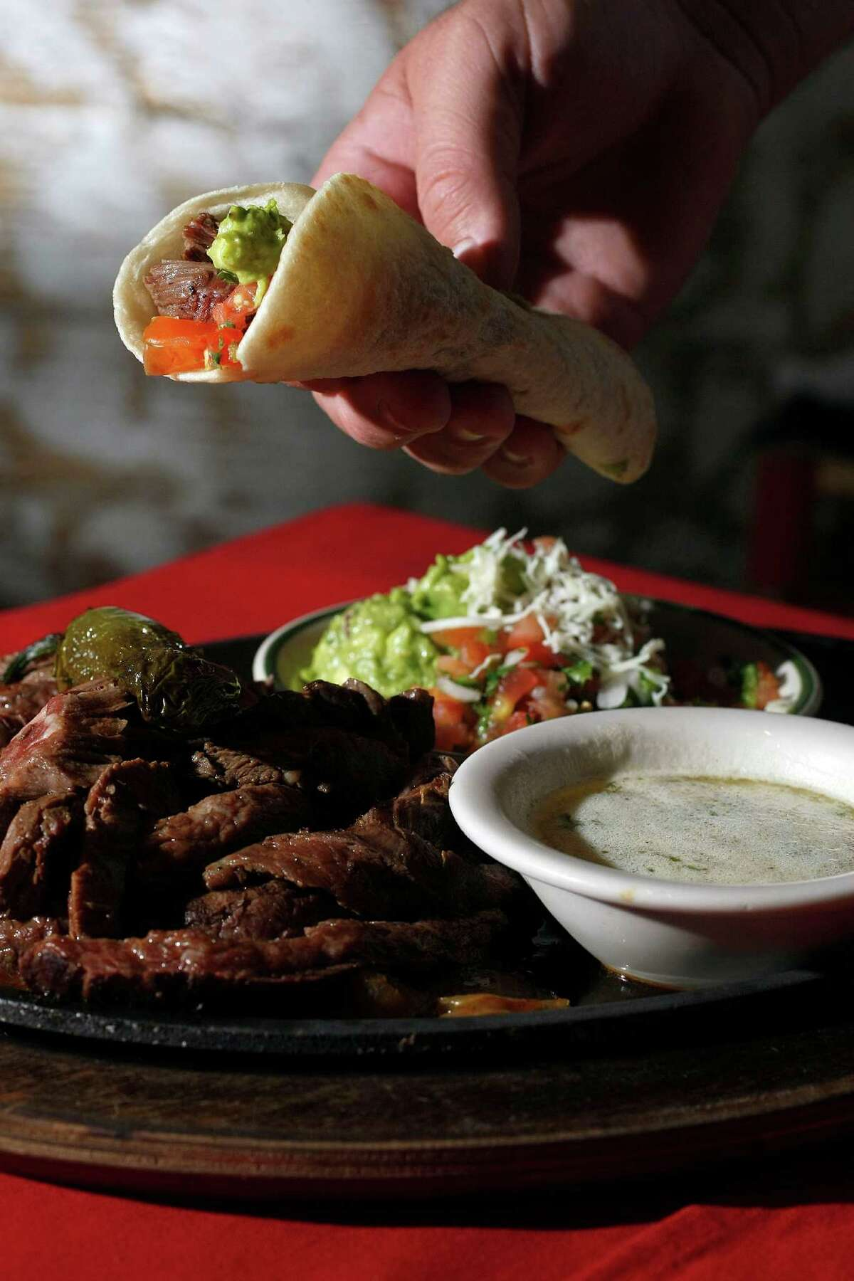 Beef fajitas, such as these at El Real, have become an American favorite.