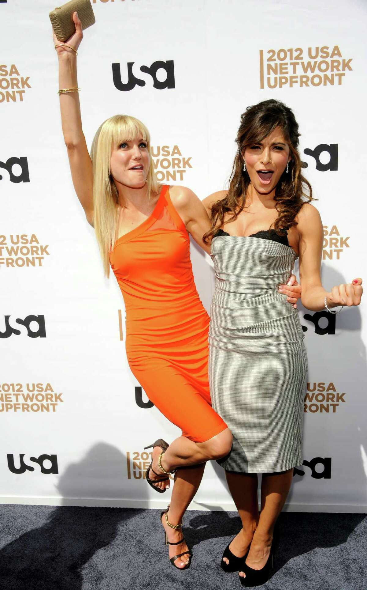"""""""Fairly Legal"""" cast members Virginia Williams, left, and Sarah Shahi attend the USA network upfront presentation at Alice Tully Hall, Thursday, May 17, 2012 in New York."""
