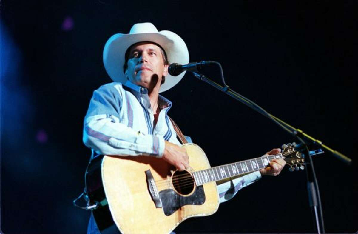 George Strait performs at the Alamodome in 1996.