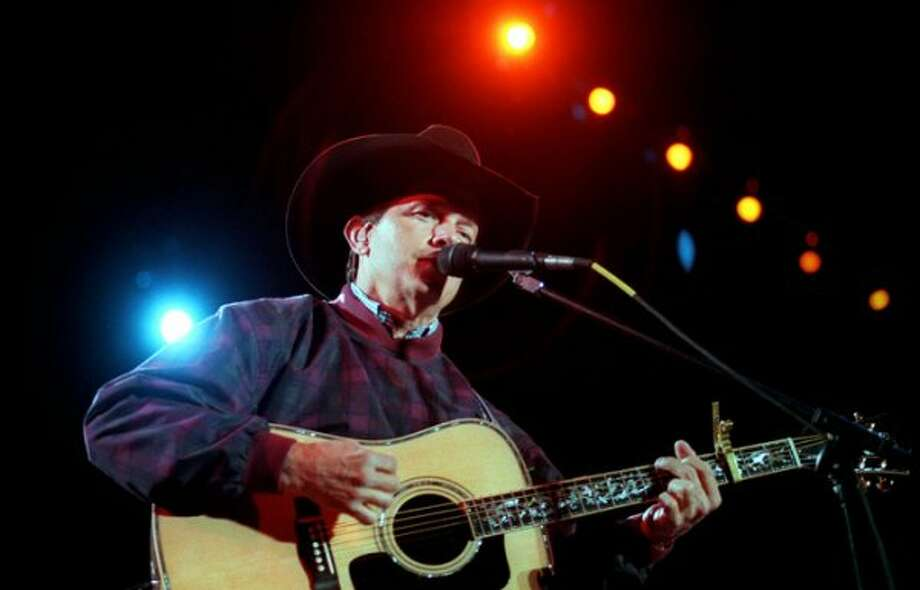 George Strait performs one of his many hits during the Nokia Presents The George Strait Chevy Truck Country Music Festival at Sun Devil Stadium in Tempe AZ Saturday March 6, 1998.
