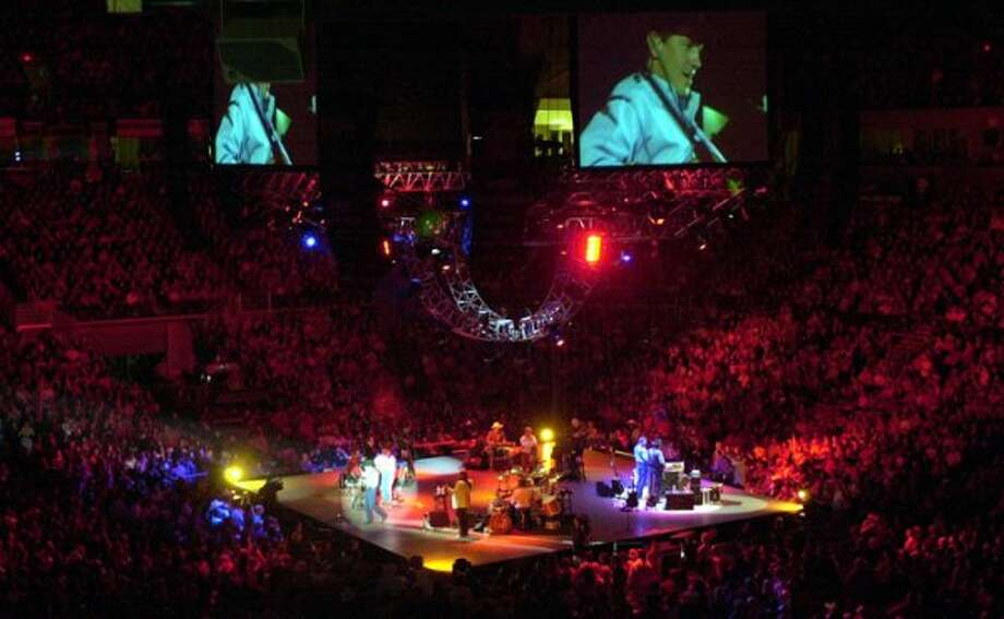 George Strait performs Thursday, Oct. 17, 2002 at the United Spirit Arena in Lubbock, Texas.