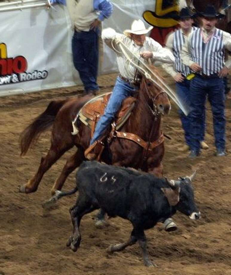 George Strait competes in Team Roping at the San Antonio Stock Show and Rodeo, 2003.