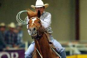 Country singer George Strait pulls back after roping a steer during the George Strait Team Roping Classic held at the Rose Palace in Leon Springs, Friday, Mar. 19, 2004.   (Bob Owen / SAN ANTONIO EXPRESS-NEWS)