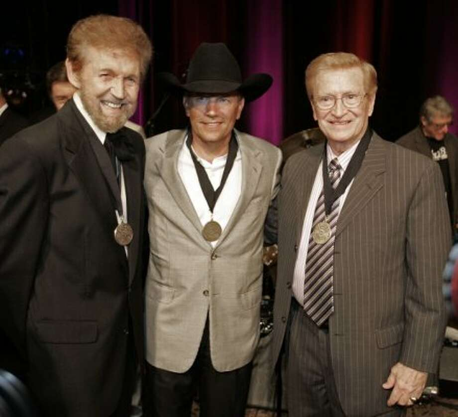 Sonny James, left, George Strait, center, and Harold Bradley, right, display their Country Music Hall of Fame medallions following the presentation ceremony on Sunday, May 6, 2007 in Nashville, Tenn. The ceremony honors the most recent inductees of the Country Music Hall of Fame.
