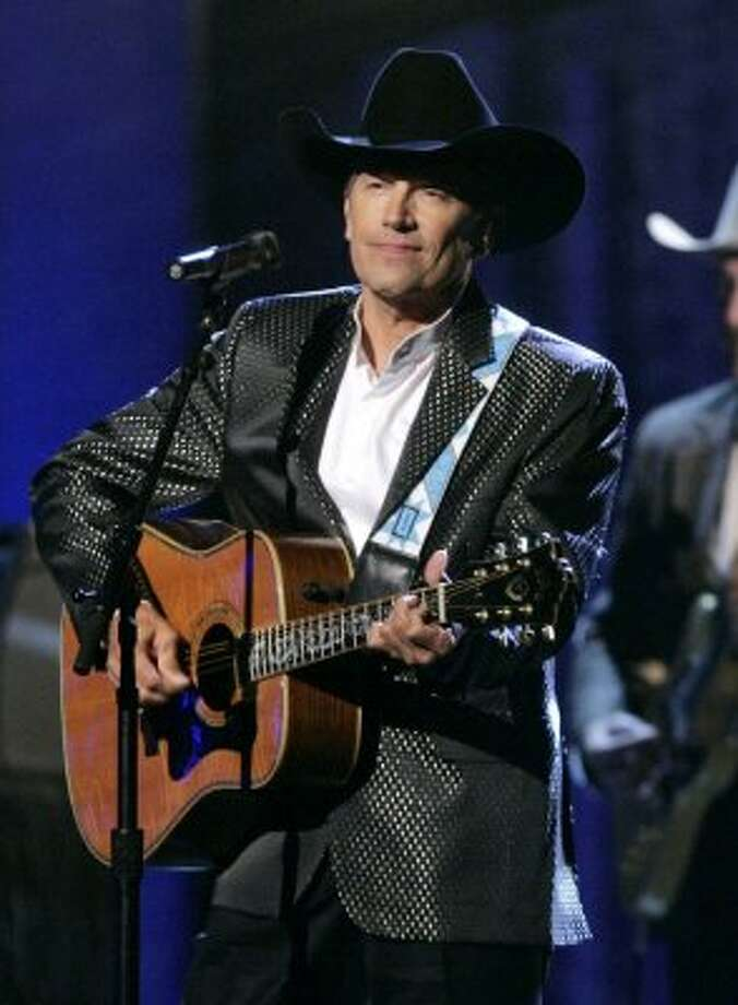 In this Nov. 7, 2007 file photo, George Strait performs at the 41st Annual Country Music Association Awards in Nashville, Tenn.
