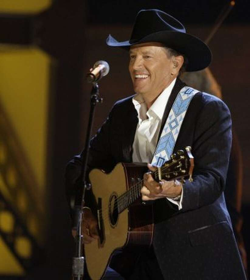 "Musician George Strait performs ""River of Love"" at the 42nd Annual CMA Awards on Wednesday Nov. 12, 2008 in Nashville, Tenn."