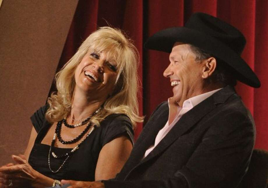 George Strait, right, and wife  Norma Voss are seen at the ACM Artist of the Decade All Star Concert on Monday,  April 6, 2009, in Las Vegas.  George Strait is the recipient of the Artist of the Decade award.