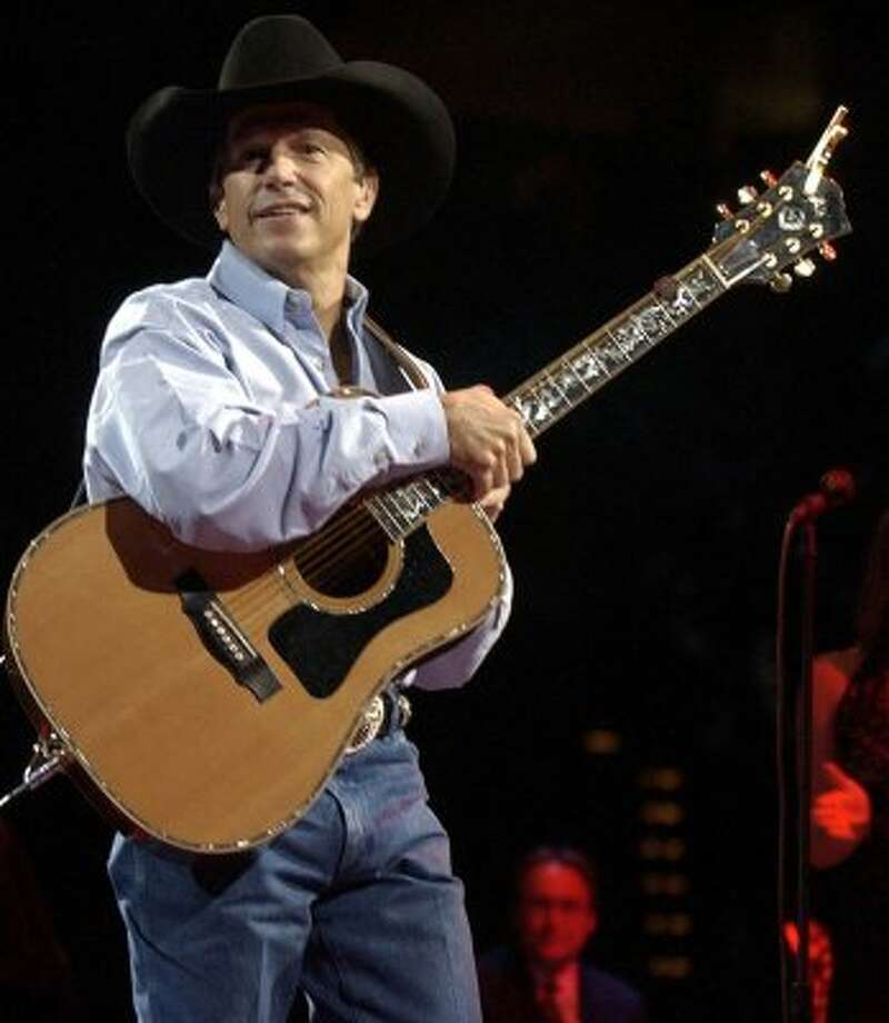 George Strait performs Saturday night November 2, 2002 at the SBC Center. Strait's performance was the first concert held in the newly opened facility.