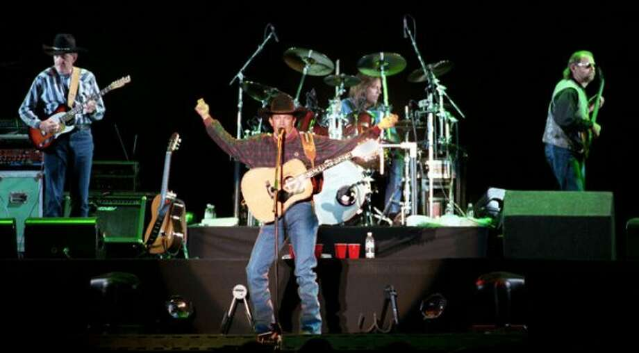 George Strait and his band, Ace in the Hole, perform during the George Strait Country Music Festival kickoff concert in Phoenix Saturday March 6, 1999. The 18-city tour stars George Strait and six other country music stars.