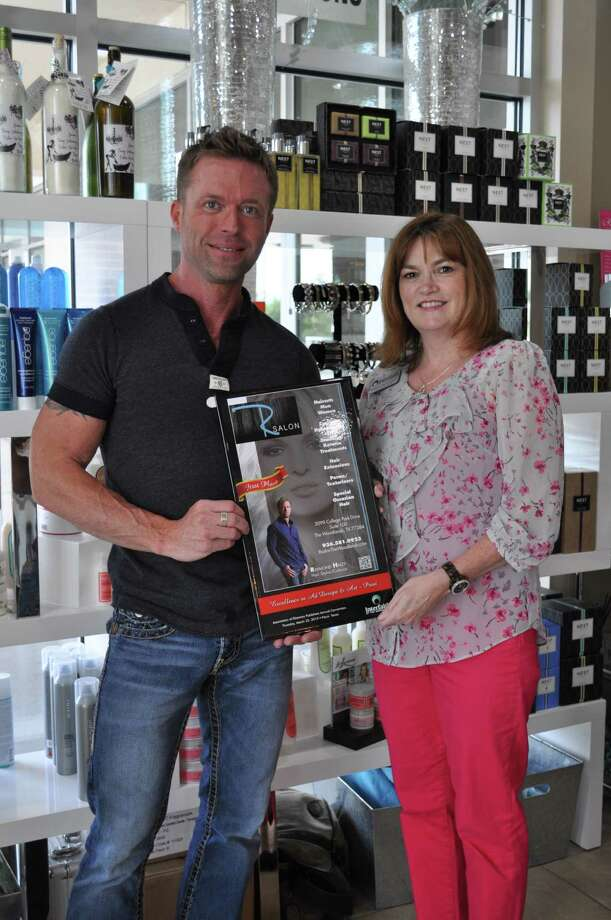 The Interfaith of The Woodlands Directory received five Gold Book awards including the ad submitted for local retailer R Salon in College Park Plaza on Hwy. 242. Pictured are Raymond Haley, owner/stylist of R Salon, and Shirley Santangelo, Senior Account