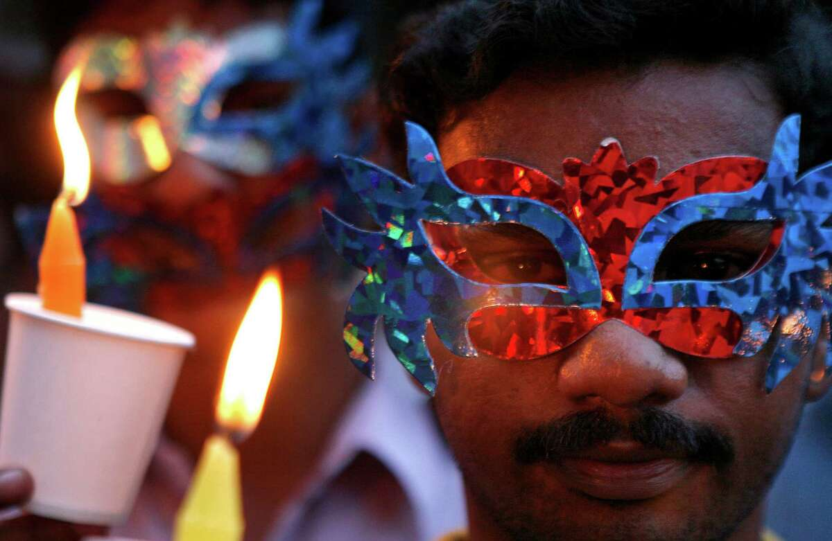 An Indian participates in a candlelight vigil organized by members and supporters of the lesbian, gay, bisexual and transgender community to mark International Day Against Homophobia in Chennai, India, Thursday, May 17, 2012. Over the last decade, homosexuals have slowly gained a degree of acceptance in some parts of India, especially its big cities. Still, being gay remains deeply taboo in most of the country, and many gays and lesbians hide their sexual orientation from friends and relatives.