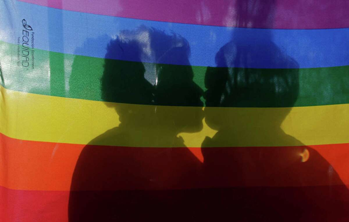 A gay couple kiss during a march on International Day Against Homophobia at the Gabriela Mistral park in Quito, Ecuador, Thursday, May 17, 2012.