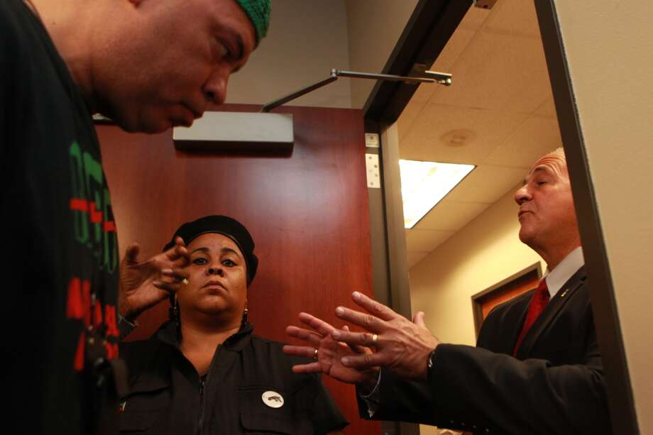 First assistant district attorney Jim Leitner talks with Kofi and Krystal Muhammad, who refused to leave after not being allowed to join a meeting of black leaders and Pat Lykos. Photo: Johnny Hanson, Houston Chronicle