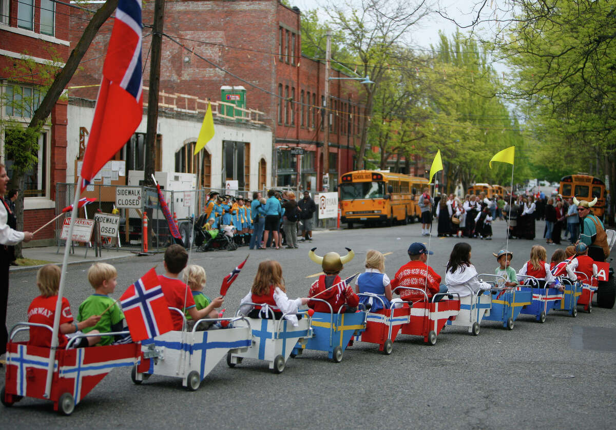 Kids ride in carts during the Syttende Mai parade in Ballard on Thursday, May 17, 2012. The Syttende Mai Celebration is held every year on the 17th of May and celebrates Norway's Constitution Day.