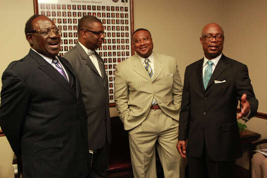 From left, the Rev. James Nash, Robert Muhammad, Quanell X and the Rev. James Dixon at Harris County District Attorney Pat Lykos' office Friday, May 18, 2012. (Johnny Hanson / Chronicle)