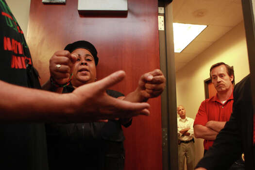 """You can arrest us right now,"" Krystal Muhammad of the New Black United Front says as she refuses to leave the Harris County District Attorney's offices Friday, May 18, 2012. (Johnny Hanson / Chronicle)"