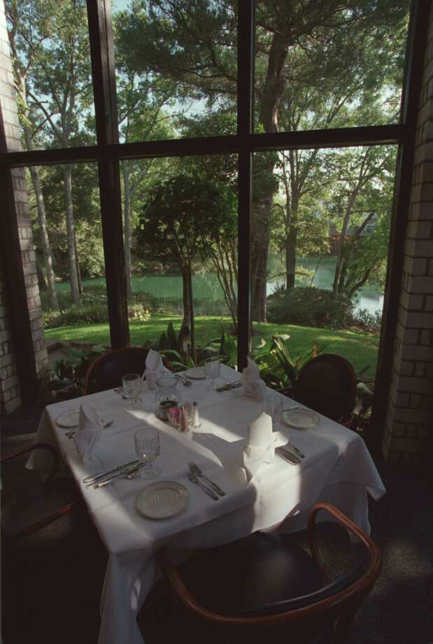 A photo from 2000 shows Vargo's a shady, parklike setting with massed azaleas, a lake, peacocks and bridges. Photo: John Everett, Houston Chronicle / Houston Chronicle