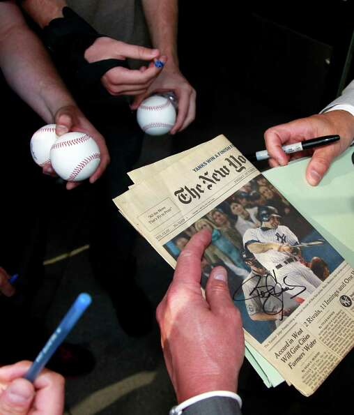 Autograph seekers wait for Former Major League Baseball pitcher Roger Clemens to sign autographs af