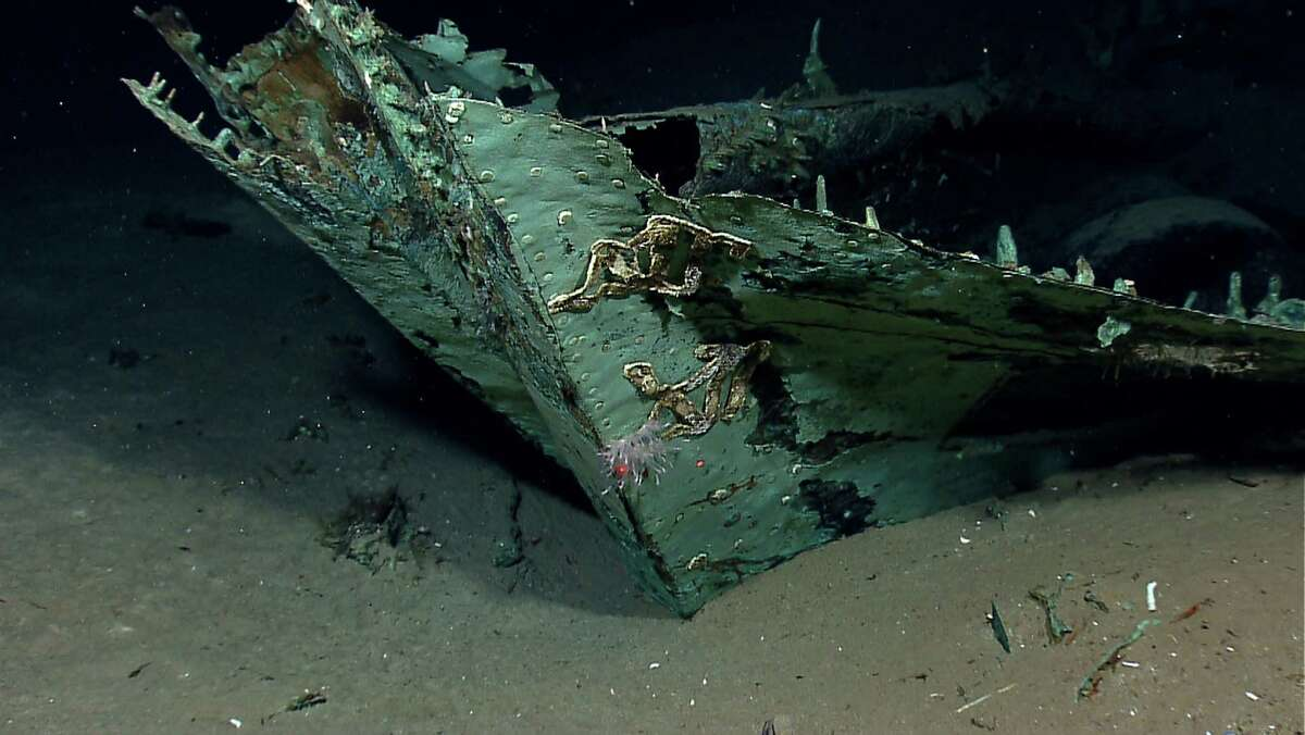 In this photo provided by NOAA Okeanos Explorer Program, a well preserved shipwreck is seen about 200 miles off the coast of Louisiana, at a depth around 4,000 feet, in the Gulf of Mexico. While most of the ship's wood has long since disintegrated, copper that sheathed the hull beneath the waterline as a protection against marine-boring organisms remains, leaving a copper shell retaining the form of the ship.
