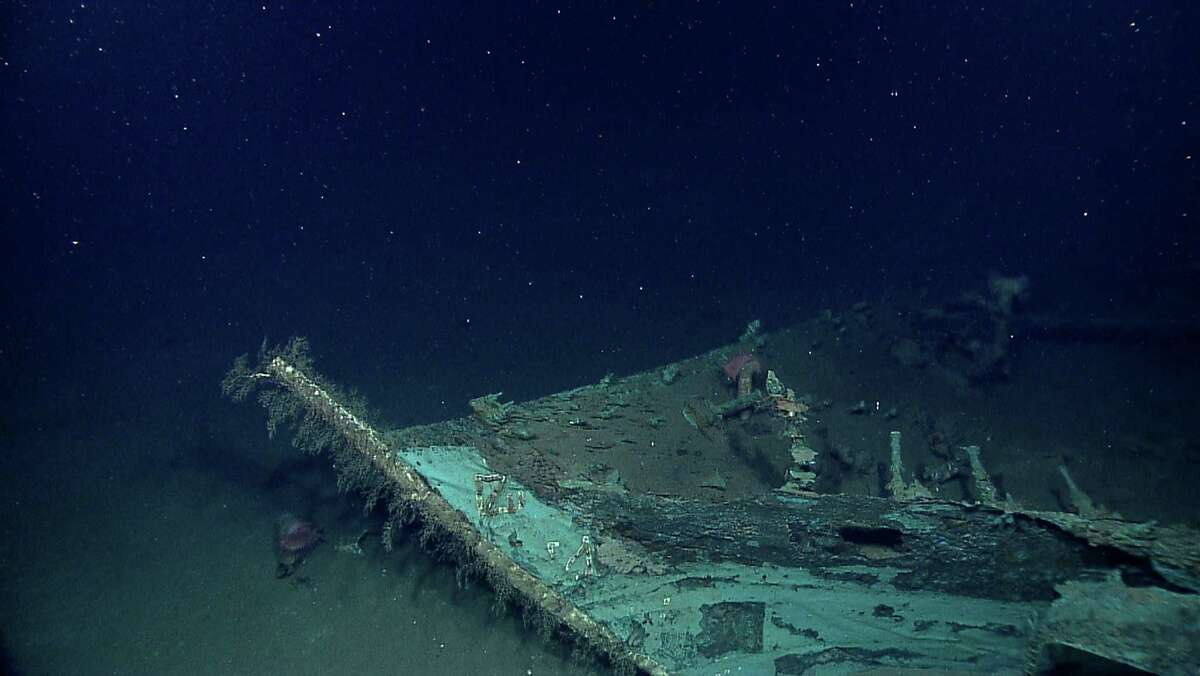 In this photo provided by NOAA Okeanos Explorer Program, a well preserved shipwreck, roughly 200 years old, is seen about 200 miles off the coast of Louisiana, at a depth around 4,000 feet, in the Gulf of Mexico. Clearly visible on the bow are lead draft marks, Roman numerals VI and VII, which were used to indicate how the ship was loaded.