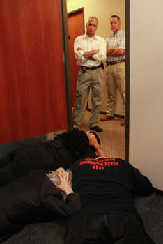 New Black United Front members and others protest by laying down, not unlike Chad Holley before his controversial arrest and police beating in 2010, in the office of Harris County District Attorney Pat Lykos Friday, May 18, 2012. (Johnny Hanson / Chronicle)