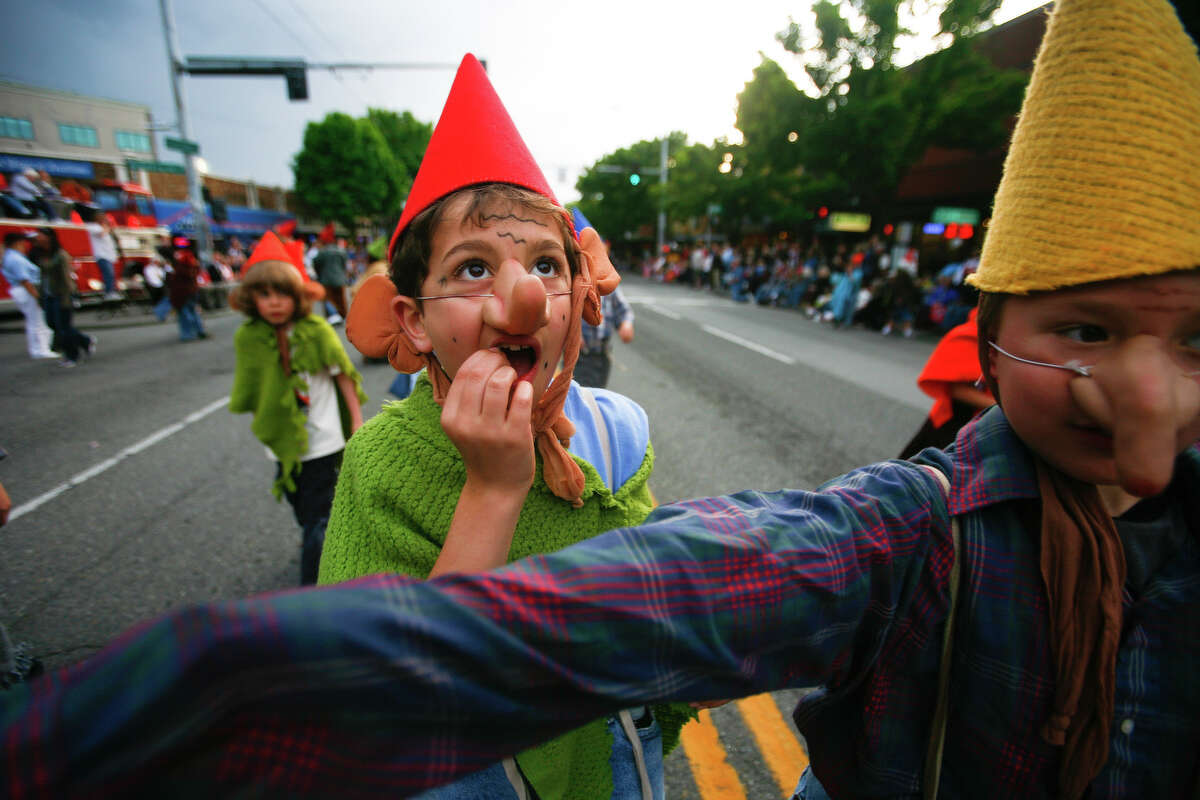 Kids dressed as gnomes run around during the Syttende Mai parade in Ballard. The Syttende Mai Celebration is held every year on the 17th of May in order to celebrate Norway's Constitution Day.