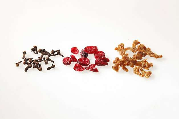 Left-right: Whole Cloves, Cranberries, and Turkey Skin Cracklings (for Turkey & Cranberry Sausage from The Whole Beast, John Fink) as seen in San Francisco on April 4, 2011. Photo: Craig Lee, Special To The Chronicle