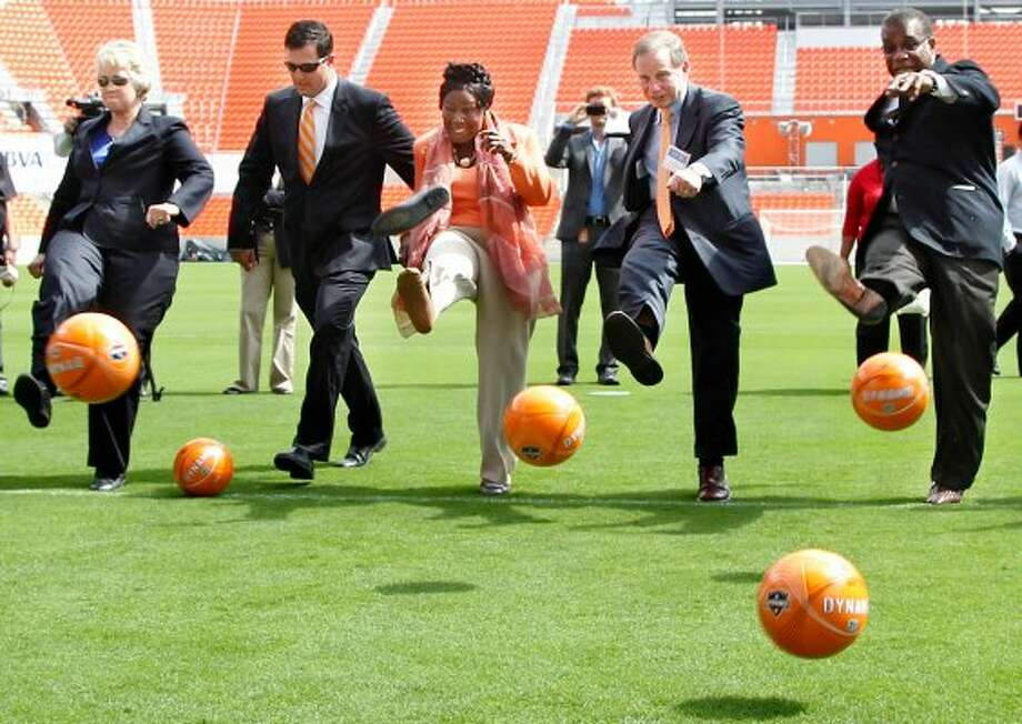 Rep. Sheila Jackson Lee loses her shoe while  Houston Mayor Annise Parker, Houston  Dynamo President Chris Canetti, Kent Friedman, Chairman of the Board Harris County Houston Sports Authority and El Franco Lee, Harris County Precinct One Commissioner kick soccer balls into the net during the Houston Dynamo and BBVA Compass Stadium ribbon-cutting ceremony on Tuesday, May 1, 2012, in Houston. (Mayra Beltran / Houston Chronicle)