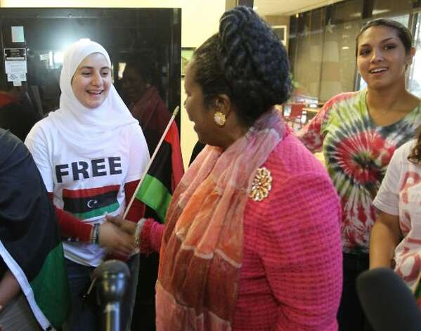 Sara Baaba of Houston shakes Sheila Jackson Lee's hand after Jackson Lee made a statement about Gadahfi's death and what she hopes to see in the North African countries future Thursday, Oct. 20, 2011, in the Mickey Leland Federal Building in Houston. (Nick de la Torre / Houston Chronicle)