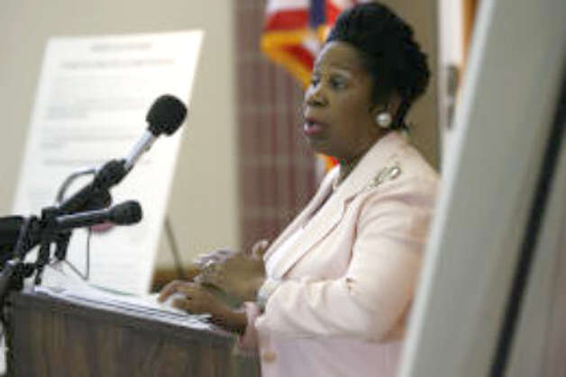 Rep. Sheila Jackson Lee stands at the spot where Rev. Martin Luther King Jr. was assassinated at the Lorraine Motel, in Memphis, Tenn. on Friday, April 4, 2008. (The Associated Press)