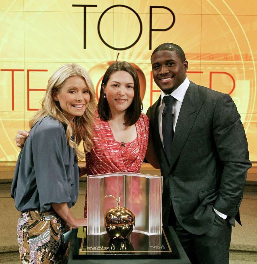 """""""Top Teacher Search"""" finalist Kristin Golia, center, with Kelly Ripa, host of """"LIVE! with Kelly,"""" and Reggie Bush, Miami Dolphins football star who was Ripa's co-host Friday. Photo: Lou Rocco, Contributed Photo/Disney-ABC Dom / ©2012 Disney-ABC Domestic Television.  All rights reserved. NO ARCHIVING. NO RESALE."""