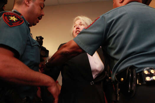 Attorney Maria Elena Castellanos is arrested for criminal trespass at the Harris County District Attorney's Office  Friday afternoon May 18, 2012, after refusing to leave. (Johnny Hanson / Chronicle)