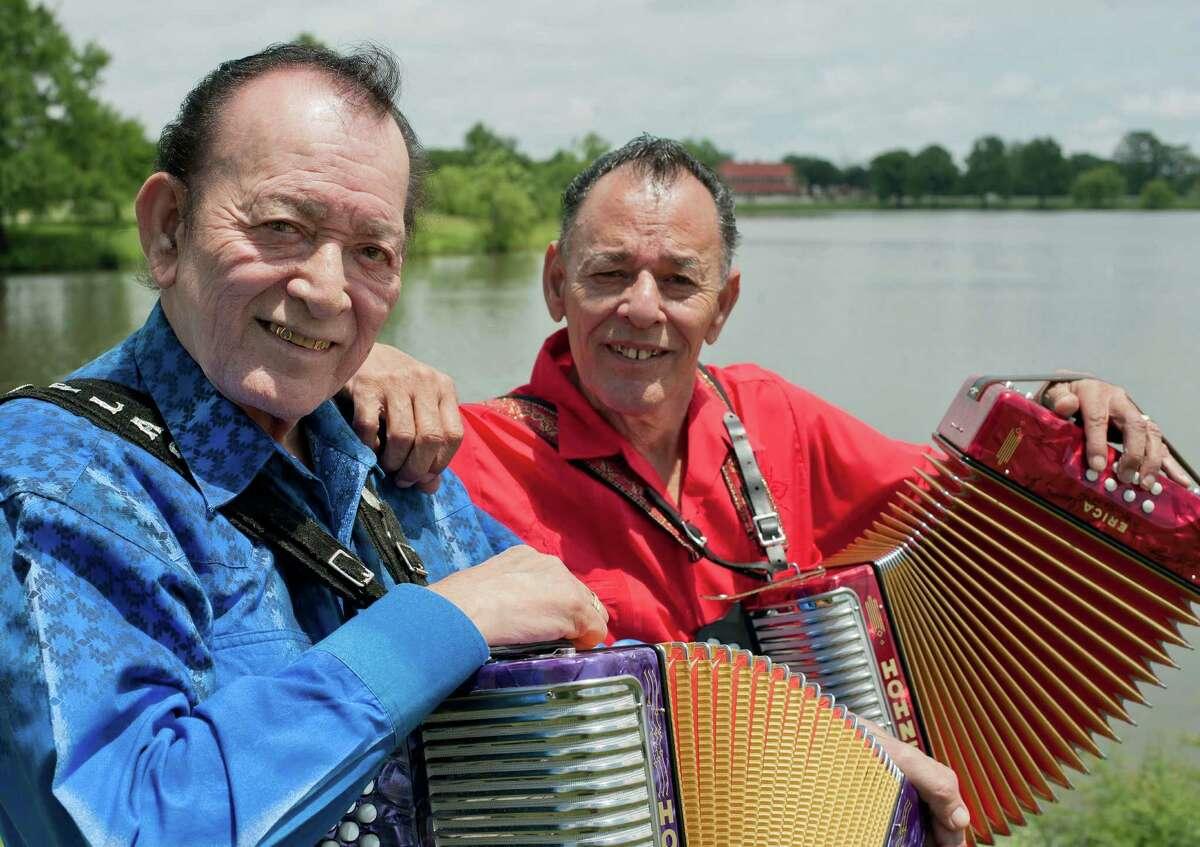 Flaco Jimenez, left, and Santiago Jimenez, Jr. pose for a portrait, Tuesday, May 15, 2012, at Woodlawn Lake in San Antonio.