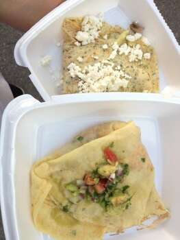 Two savory crepes from Crepe Nation, based out of Boerne: A Mediterranean chicken crepe, bottom, and a shrimp and avocado crepe, top.