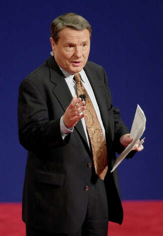 Moderator Jim Lehrer gives instructions to the audience before the presidential debate Wednesday, Oct. 11, 2000, at Wait Chapel on the campus of Wake Forest University in Winston-Salem, N.C. This is the second of three debates between Democratic candidate Vice President Al Gore and Republican candidate Texas Gov. George W. Bush.  (AP Photo/David Phillip) Photo: DAVID PHILLIP