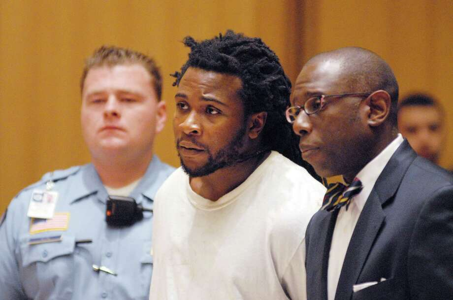 Frank Douglas of Norwalk, is arraigned in Stamford Superior (Conn) Court on Friday May 18, 2012 on charges of second-degree robbery, engaging police in a pursuit, interference with police and animal cruelty his lawyer Darnell Crosland is on his right. Photo: Dru Nadler / Stamford Advocate Freelance