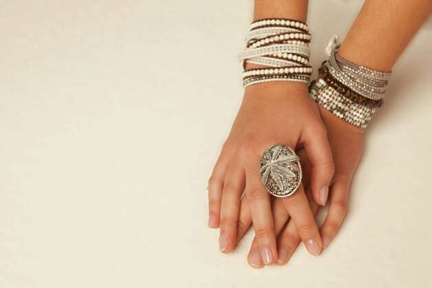 Luu's wrap bracelets are paired with a snakeskin agate ring. Photo: Courtesy, Chan Luu