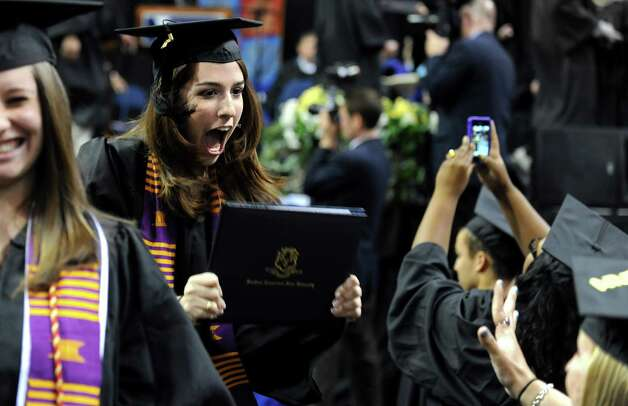 Graduate Brianna Micanovic, of Shelton, shows off her diploma during Southern Connecticut State University's commencement ceremony Friday, May 18, 2012 at the Webster Bank Arena in Bridgeport, Conn. Photo: Autumn Driscoll / Connecticut Post