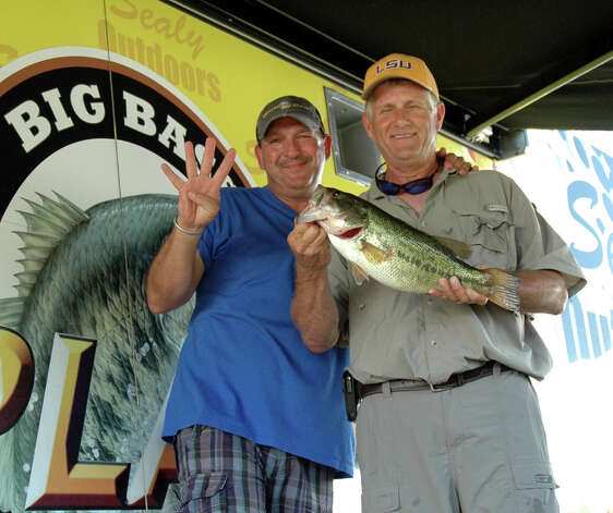 After multiple attempts and barely misses, Thomas Lee's bass was the first to lock in at 4.00 lbs to win the first of the $5,000 exact weight bonuses  Photo by Patty Lenderman / Lakecaster
