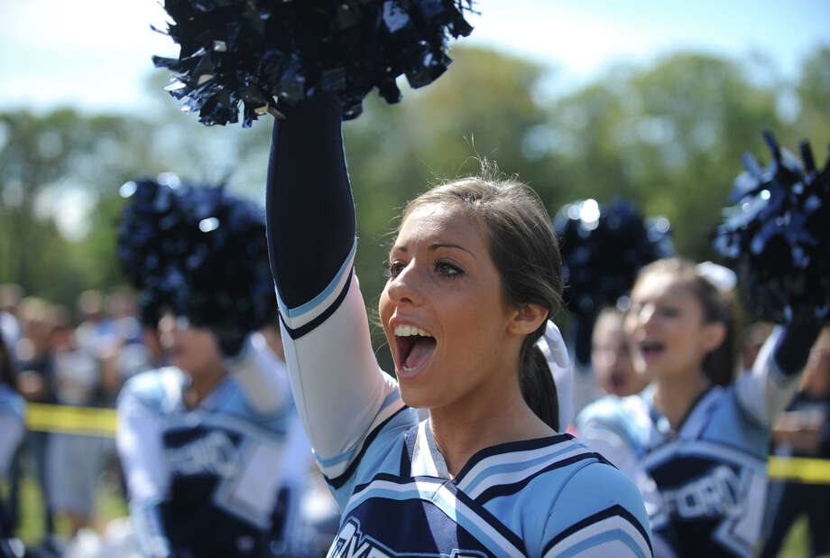 Oxford High School cheerleader Amanda Donofrio cheers for the football team during a game against Masuk High School, Sept. 17, 2011, in Oxford. Photo: Autumn Driscoll