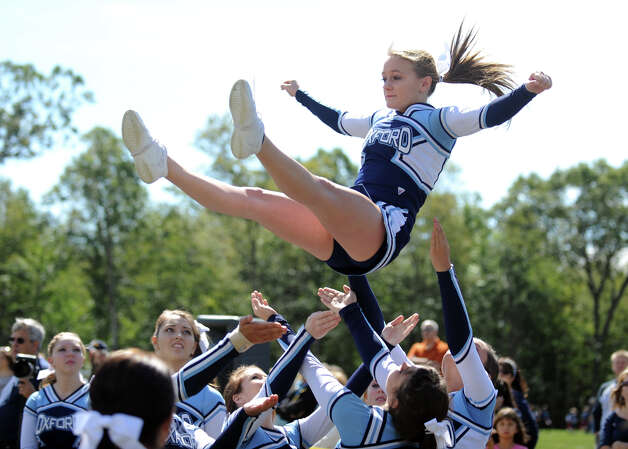 Oxford High School cheerleader Ellen Yacovelli in action on the sideline of a football game against Masuk High School, Sept. 17, 2011, in Oxford. Photo: Autumn Driscoll