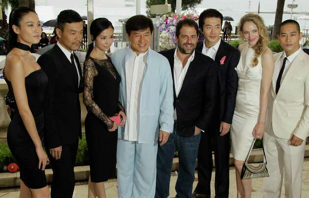 From left actors, Zhang Nan Xin, Liao Fan, Yao Xingtong, director Jackie Chan, producer Brett Ratner, actors Kwone Sang Woo, Laura Weissbecker and Steve Yoo pose during a photo call for Chinese Zodia